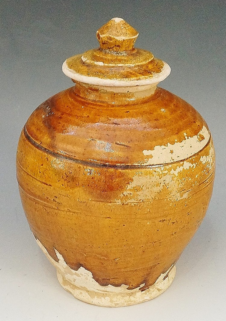 A Chinese Tang dynasty amber glazed pale terracotta baluster storage jar, 1