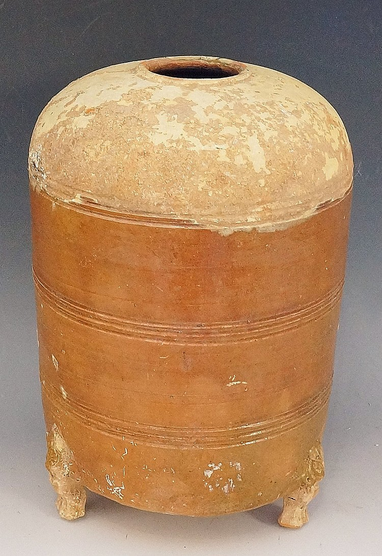 A Chinese Han period grain jar of cylindrical form, the body with brown gla