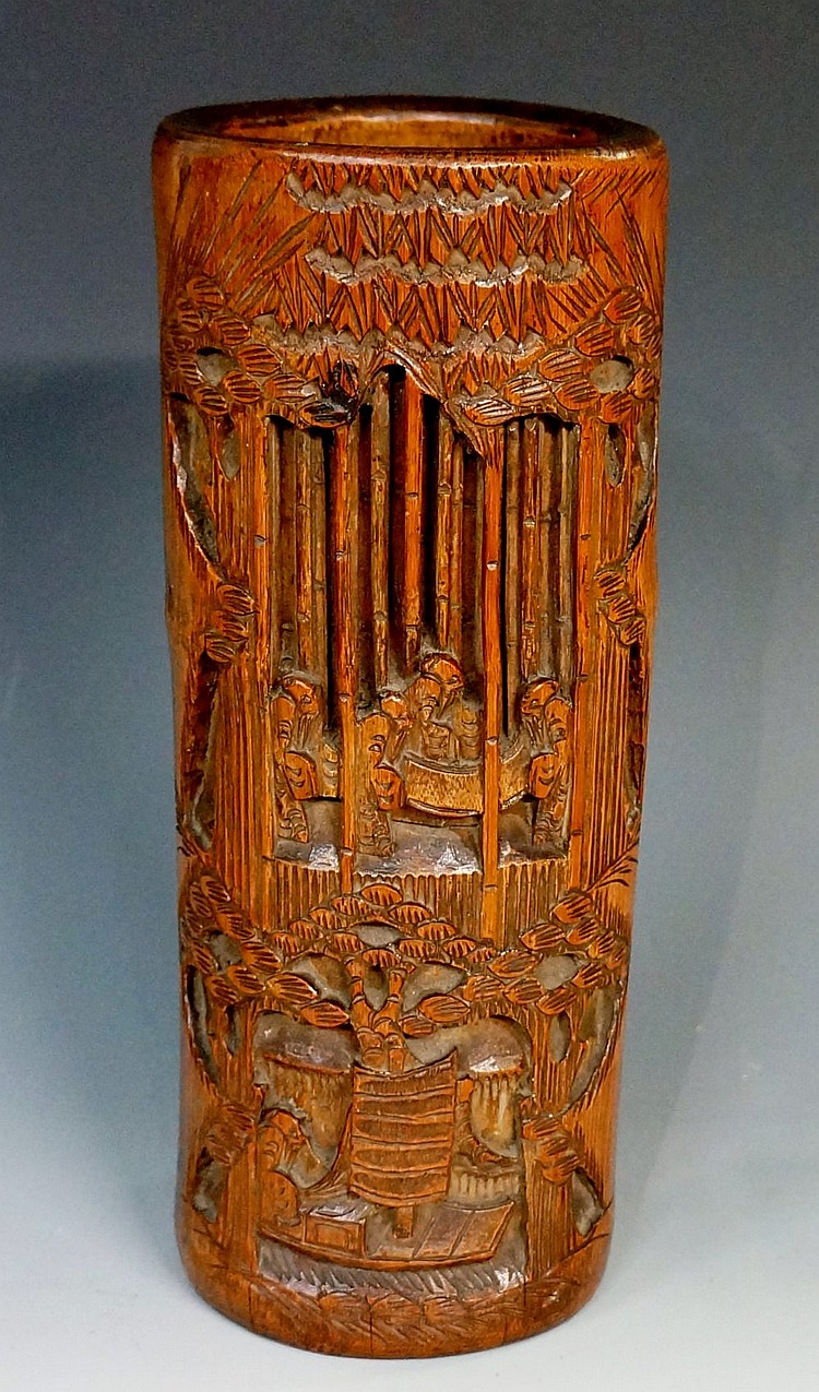 A Chinese bamboo brush pot, relief carved with figures within bamboo groves