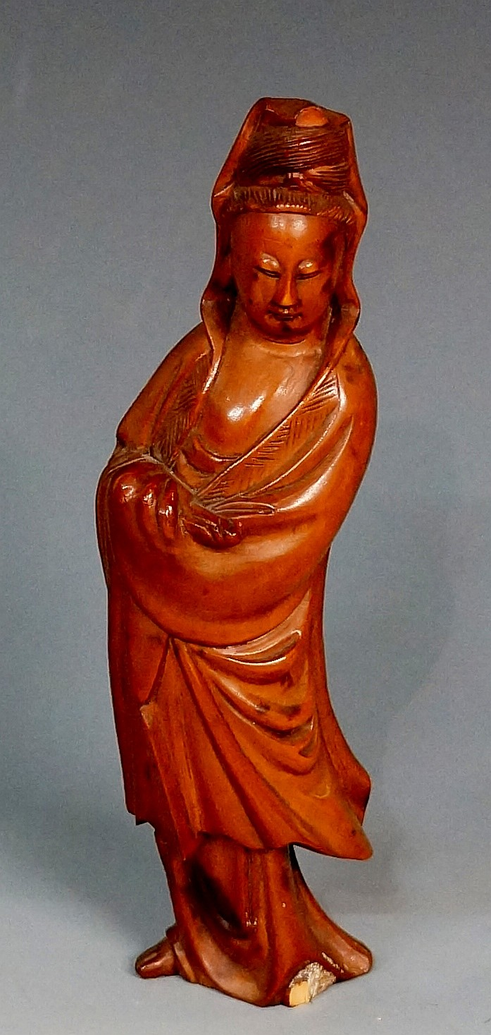 A carved boxwood figure of Guan Yin, 15.5cm high (faults)