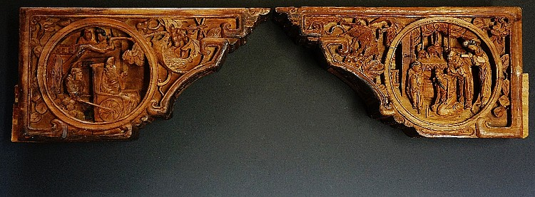 A pair of Chinese corbels, each carved with pairs of roundels, one with eld