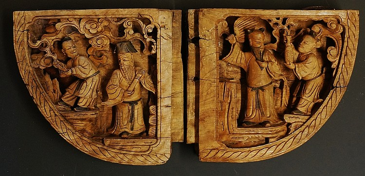 A pair Chinese corbels of quarter segment form, one side relief carved with