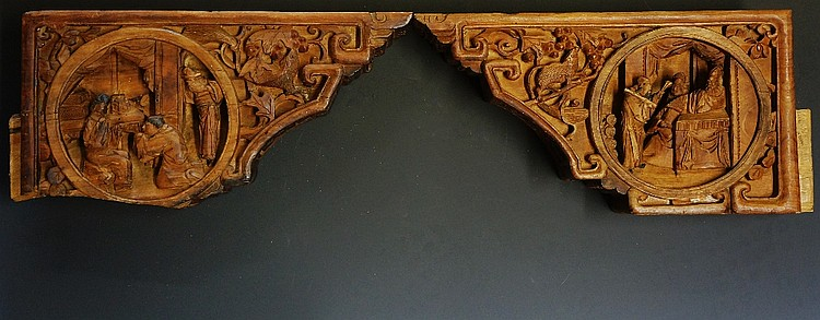 A pair of Chinese corbels, each with pair of roundels relief carved to one