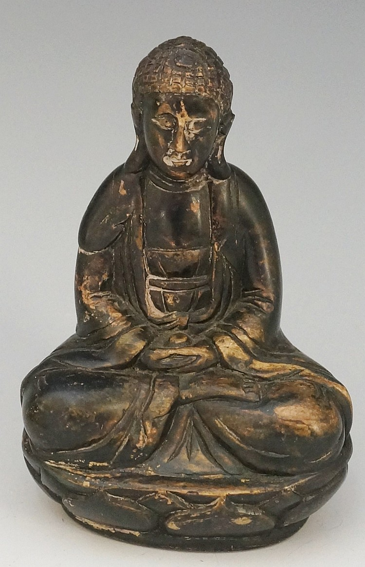 A soft stone carving of seated Buddha on lappet moulded base, 11.5cm high