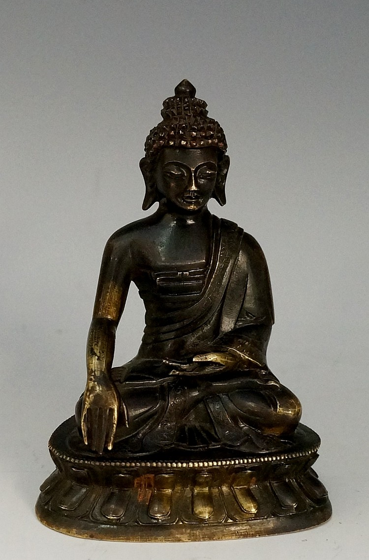 An 18th Century bronze figure of seated Buddha on a lappet cast base, 10cm