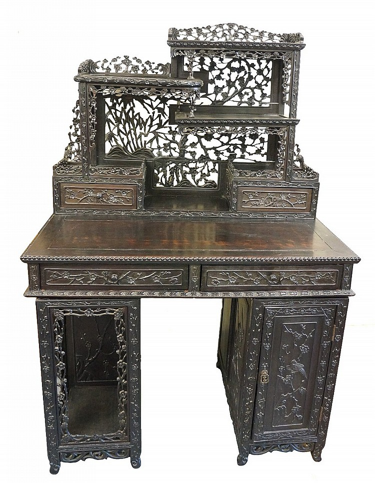 A Chinese hardwood desk of unusual form, the rear super structure finely ca