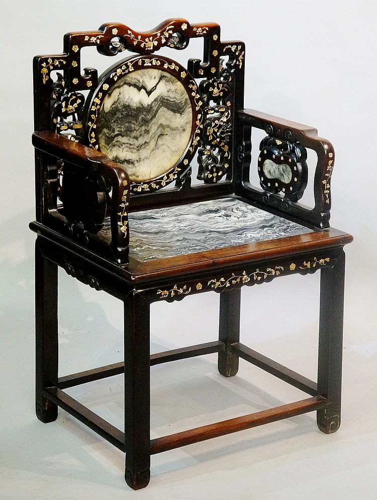 A Chinese hardwood chair inlaid overall in mother of pearl, the pierced sha