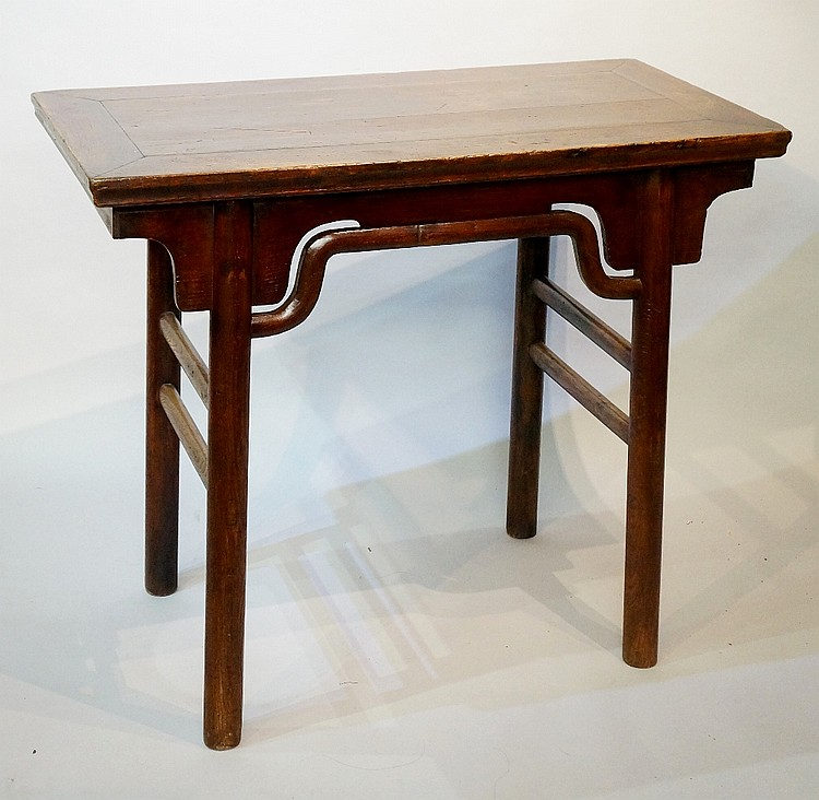 A Chinese elm topped altar table, the over sailing top above a pair of brac
