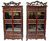A fine near pair of Chinese hardwood wardrobes the flared cornices above fr