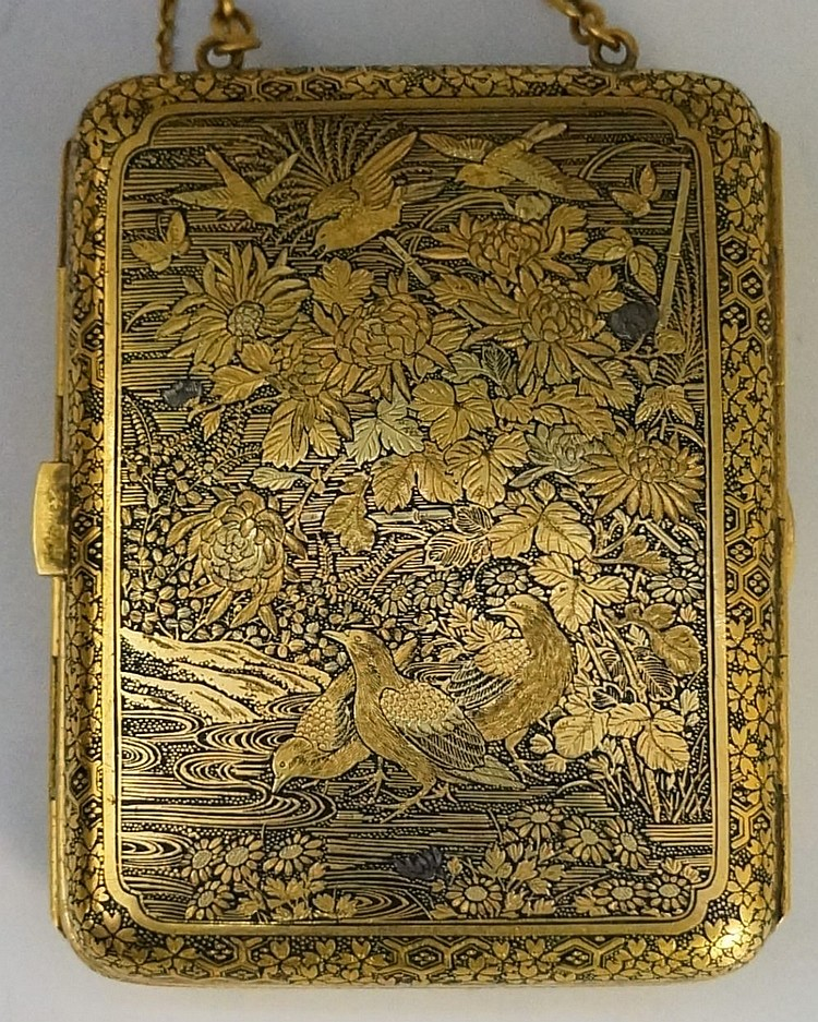 A Japanese etched damascened purse of double hinged rounded rectangular form