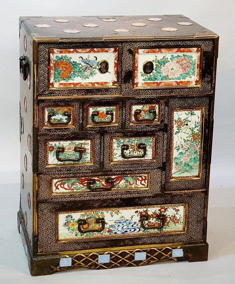 A good Japanese black lacquer cabinet decorated overall with geometric moti