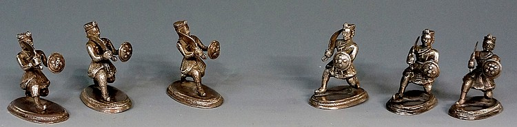 A set of six silver coloured metal figures of mogul warriors holding swords