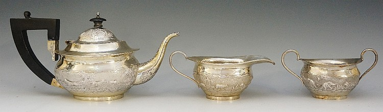 An Indian silver three piece tea service comprising: teapot, sucrier and mi