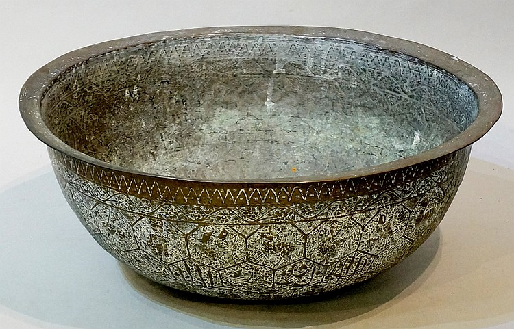 A large Islamic brass circular bowl of deep form, the body finely worked wi