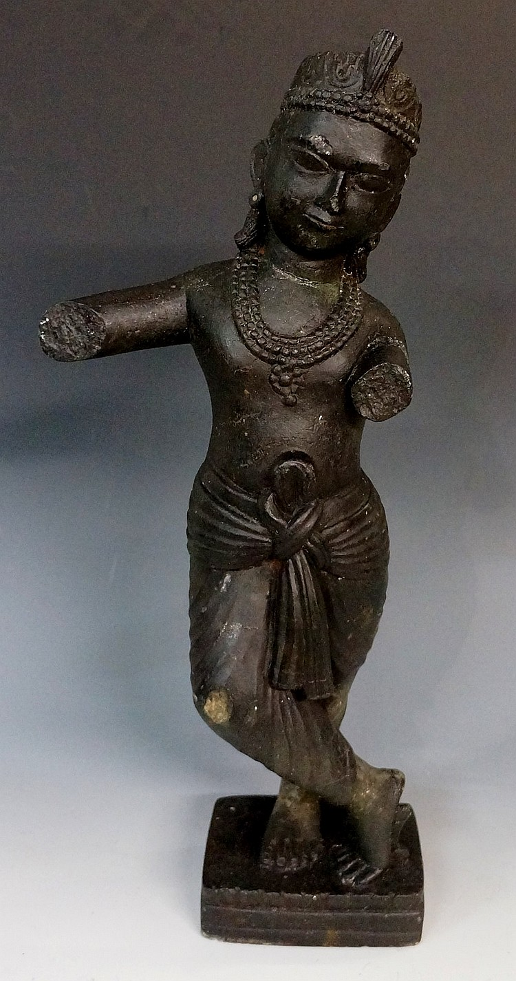 A carved figure of Krishna, 47cm high (faults)