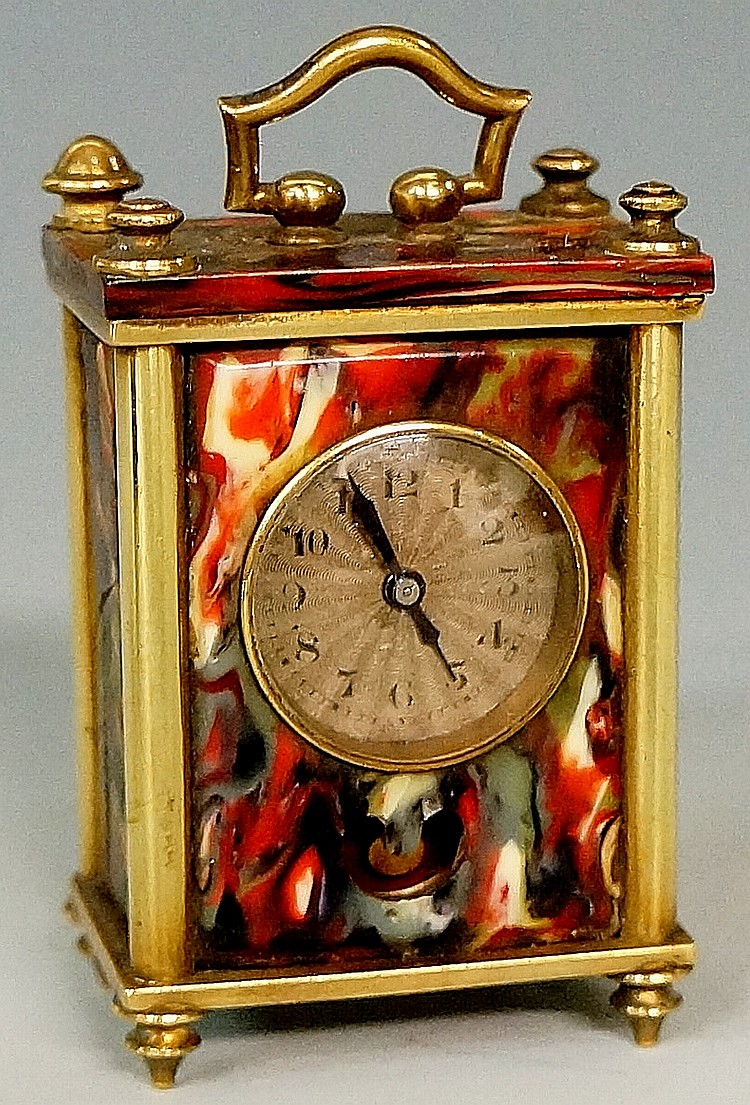 A miniature carriage clock, the coloured marbleised celluloid case with bra
