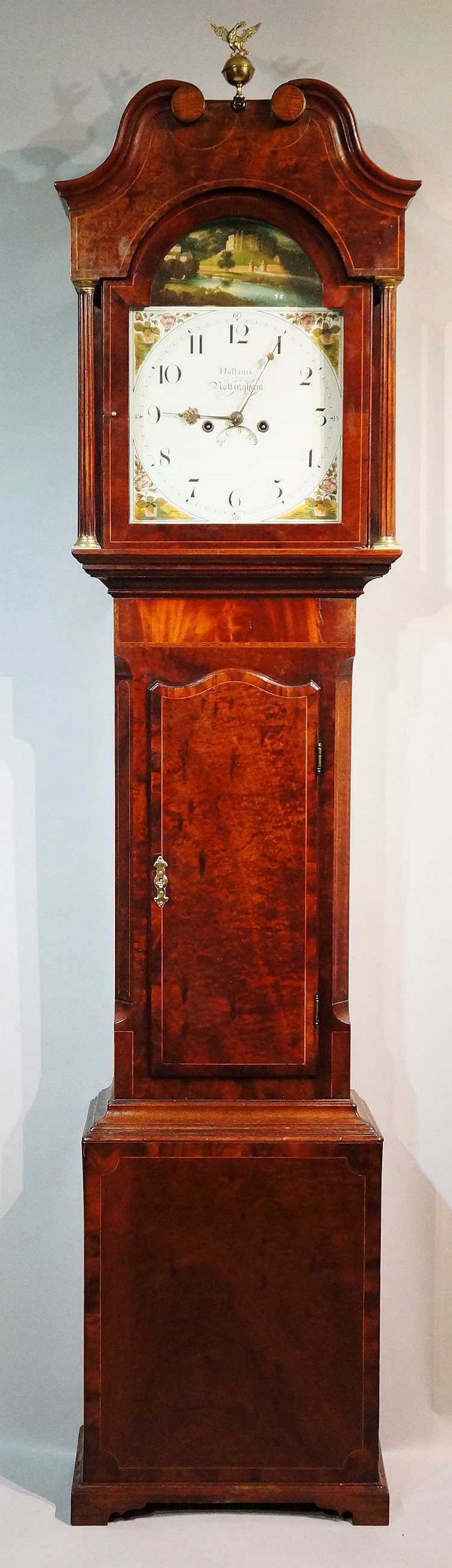 A George III mahogany longcase clock, the hood with swan neck pediment cent