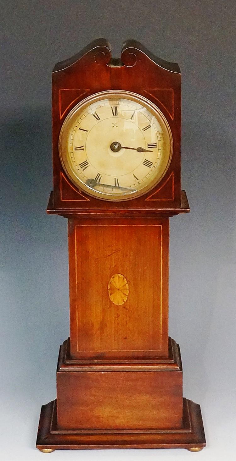 An Edwardian inlaid mahogany miniature longcase clock with stylised swan ne