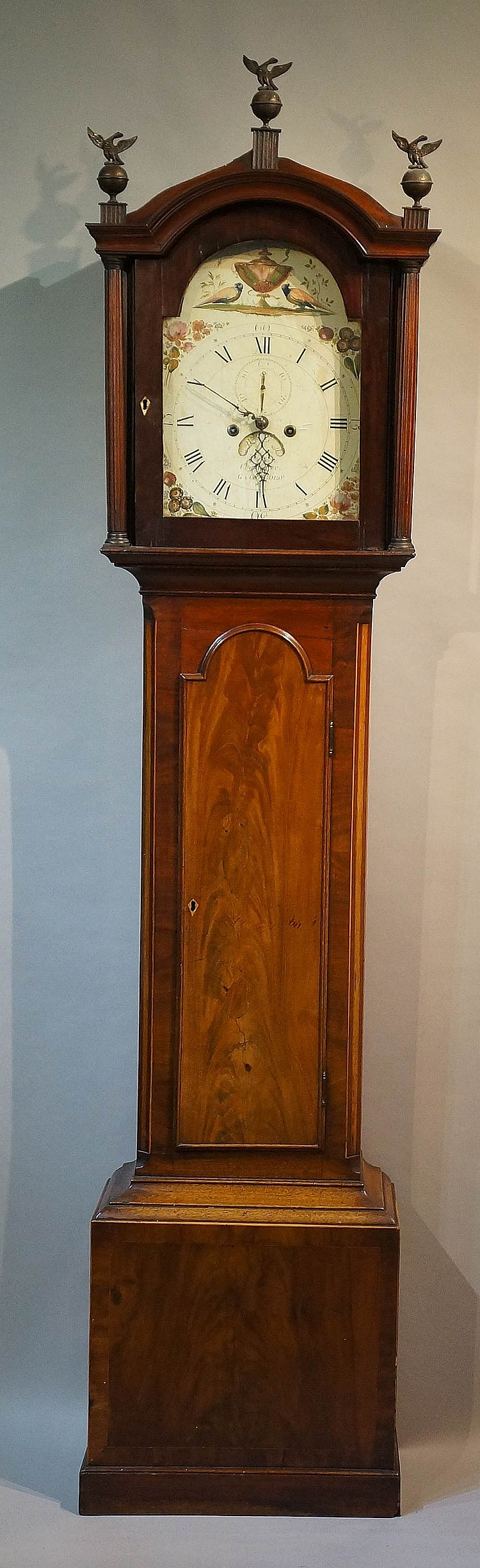 A George III mahogany longcase clock, the domed hood with cavetto moulded c