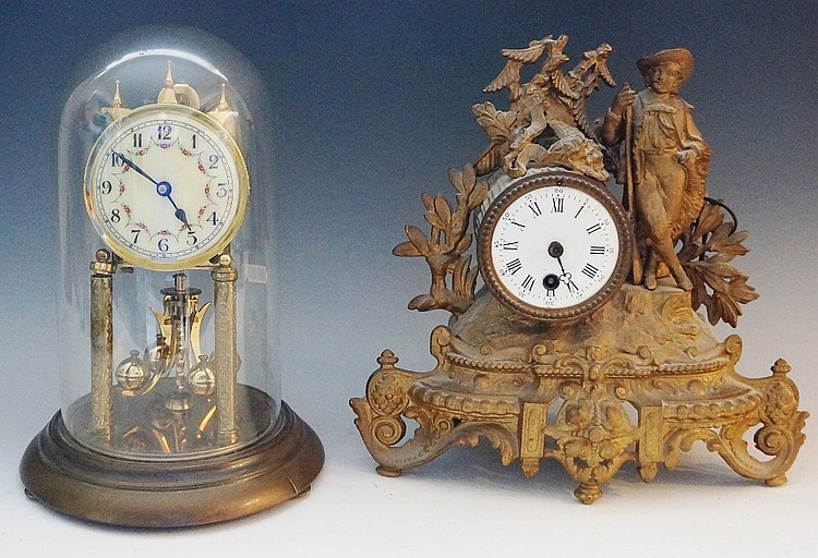 A late 19th Century gilt white metal mantel clock, the drum shaped case wit