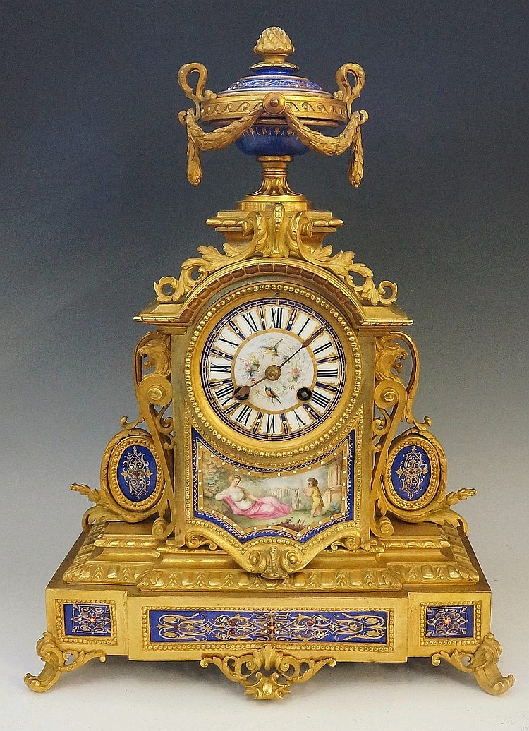 A Victorian ormolu mantel clock, the top with jeweled and gilt blue porcela