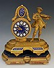 A mid Victorian ormolu mantel clock, the drum shaped case with blue enamell