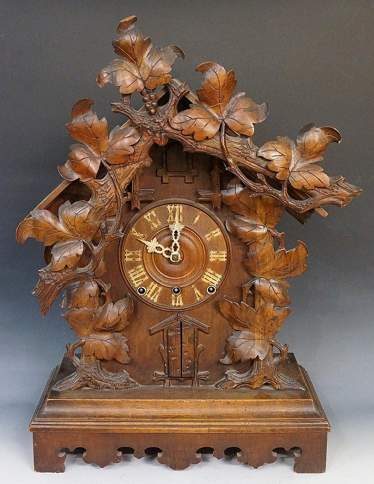 A rare Black Forest 'trumpeter' cuckoo clock of conventional design with ap