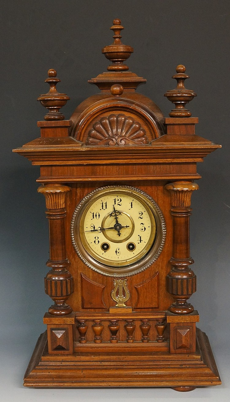 A late 19th Century German musical mantel clock, the walnut case with domed