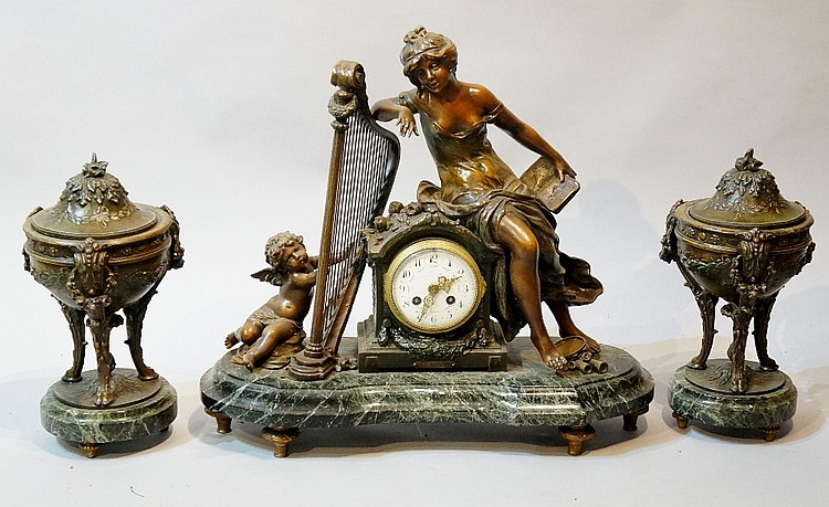 August Moreau (after) - a three piece bronzed white metal clock set compris