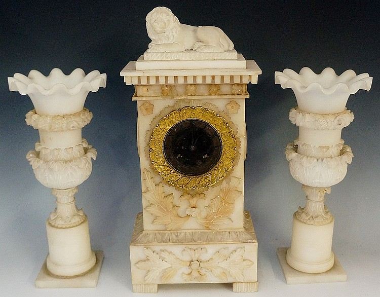 An early 19th Century alabaster three piece clock garniture, the clock with