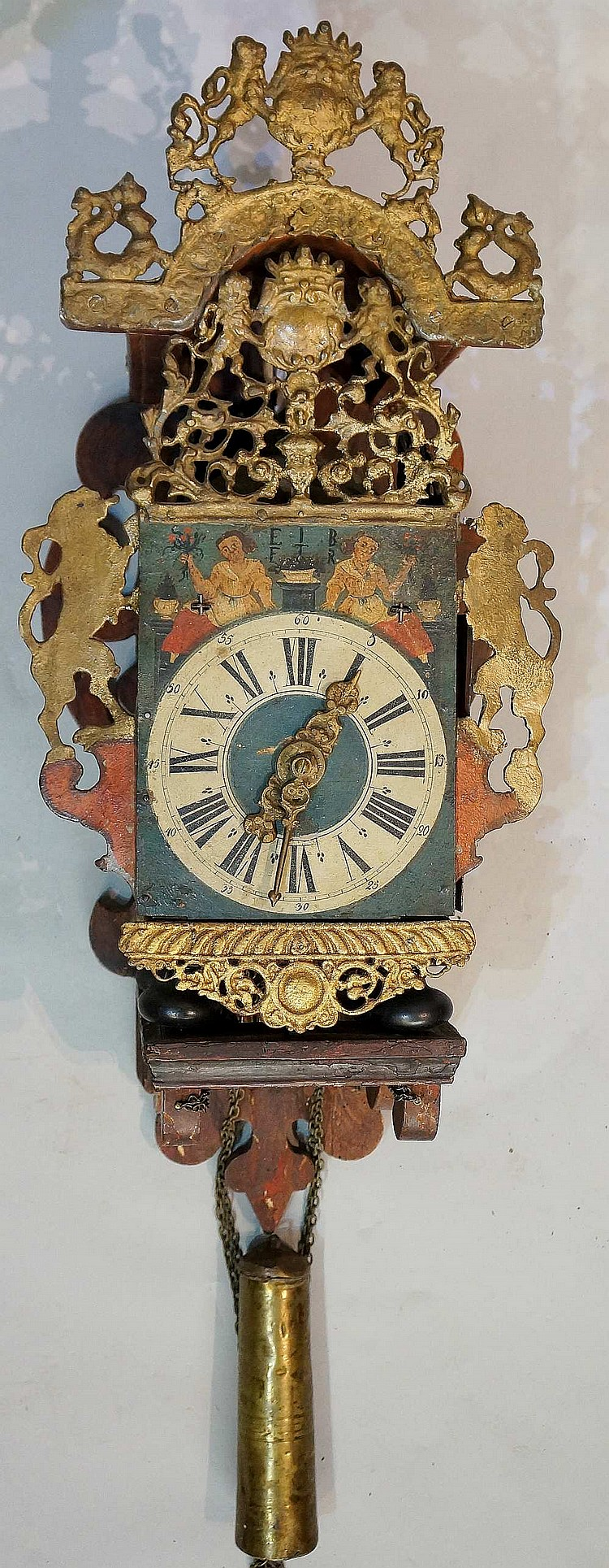 A late 18th Century Dutch polychrome decorated wall clock with gold painted