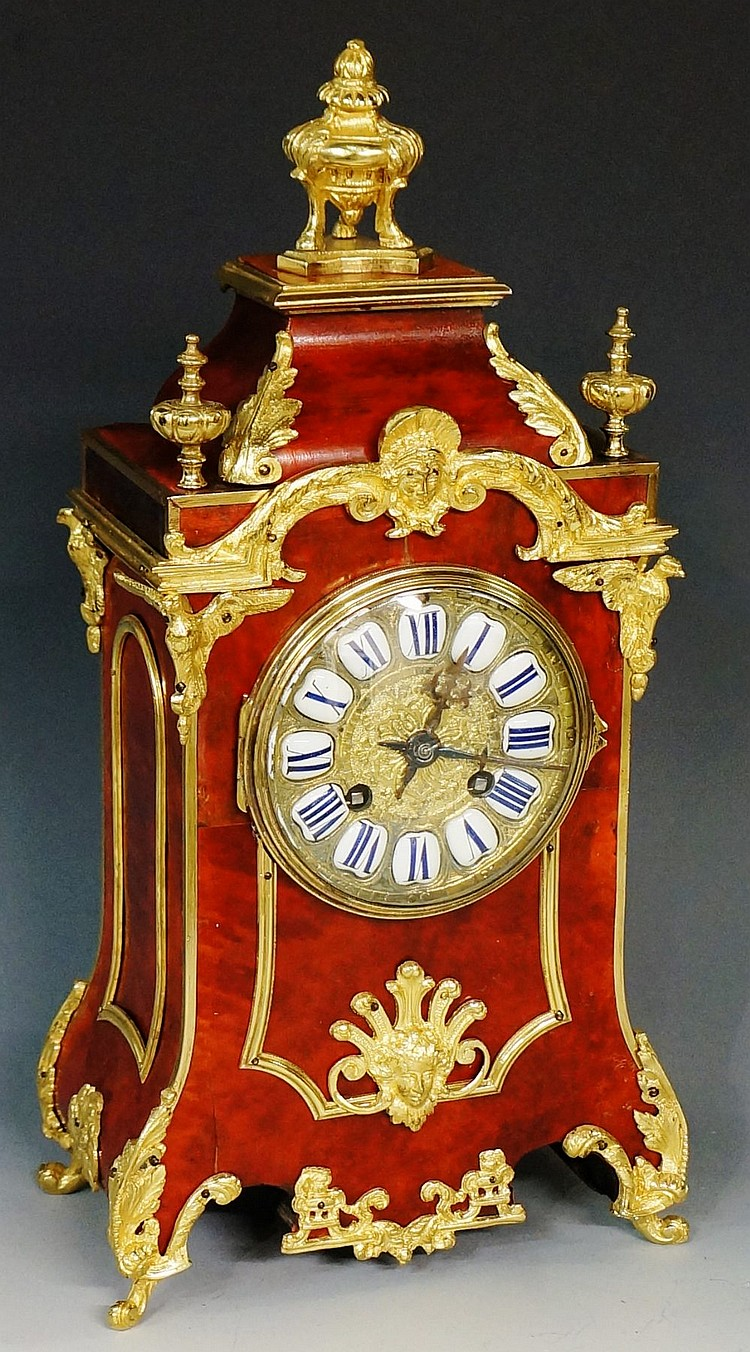 A 19th Century tortoiseshell veneered mantel clock, applied gilt metal moun