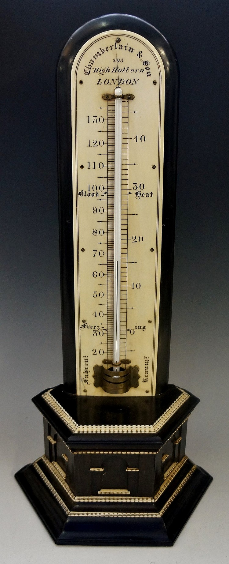 A Victorian ebony and ivory table top thermometer by Chamberlain & Son, 203