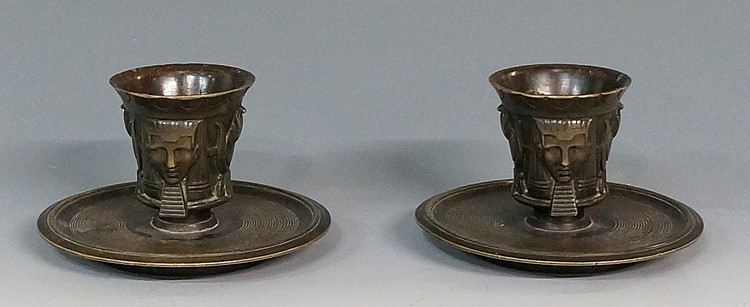 A pair of 19th Century bronze Egyptian revival table vestas, the flared cyl