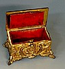 A 19th Century gilt metal 'Go To Bed', the rectangular lid cast central flo