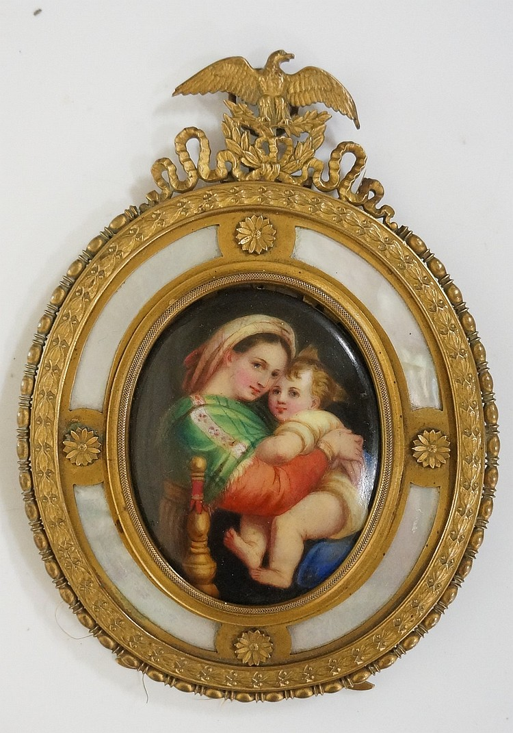 A continental oval porcelain plaque decorated with Madonna and child contai
