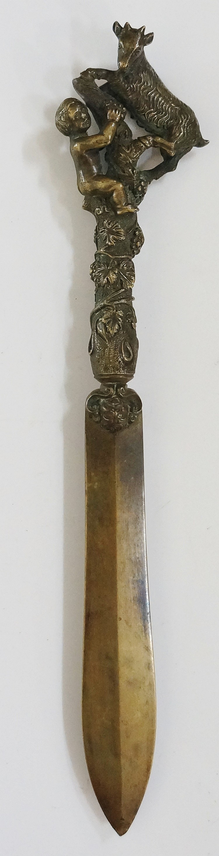 A 19th Century French bronze letter knife, the tapered blade with a handle