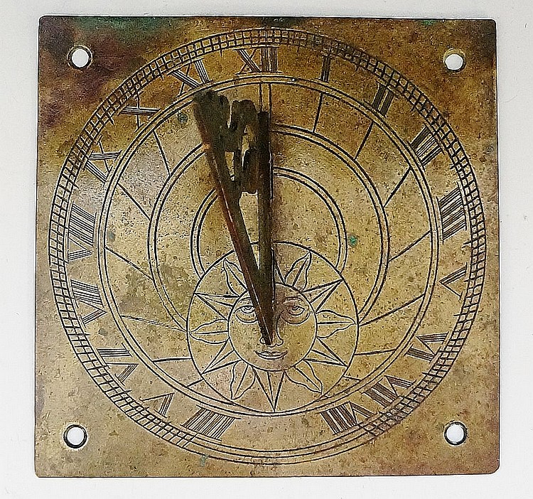 A square brass sundial engraved, the chapter ring with Roman numerals and s