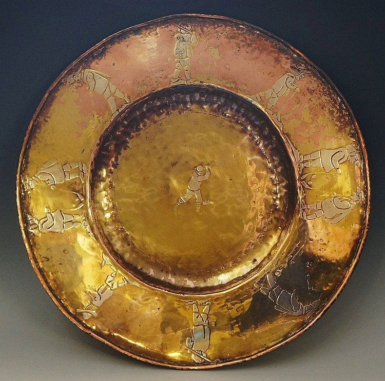 Golfing - a circular copper lacquered brass dish detailed with golfing scen