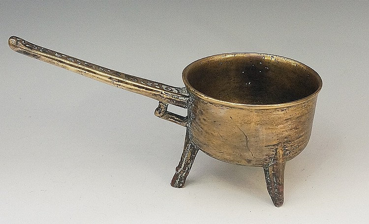 A 17th Century style handled pan, the cylindrical body on three rudimentary