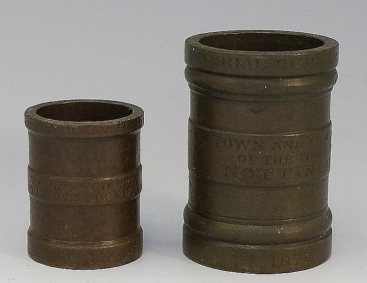Two Victorian bronze gill measures of cylindrical form with plain bands ins