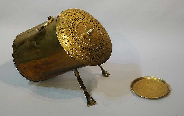 A Dutch brass coal scuttle of cylindrical form with bold shaped carrying ha