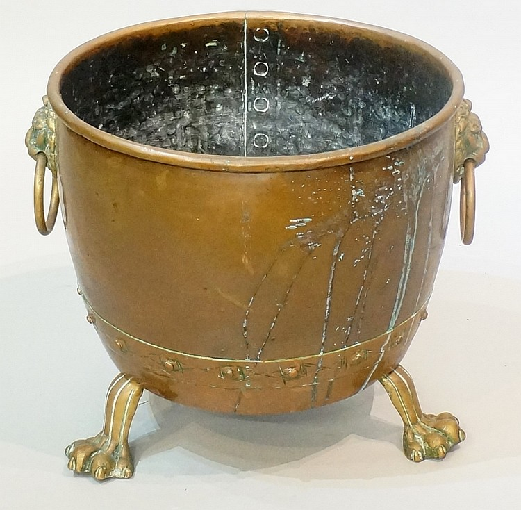 A Victorian cauldron shaped fuel bin with pair of lion mask and ring handle