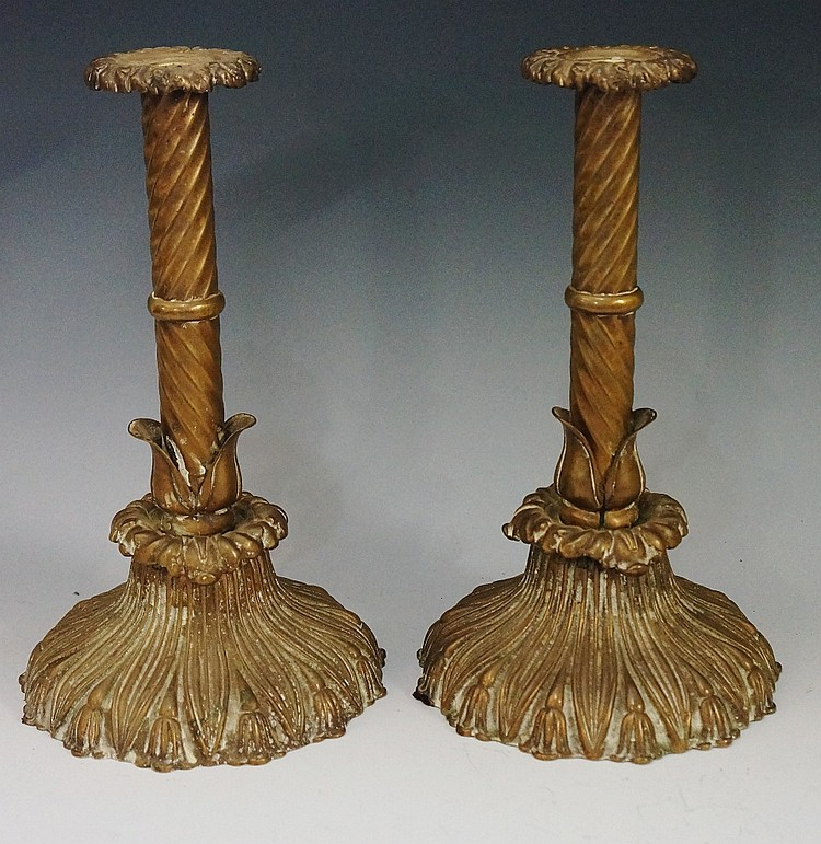 A pair of William IV brass table candlesticks, the drip pans foliate cast a