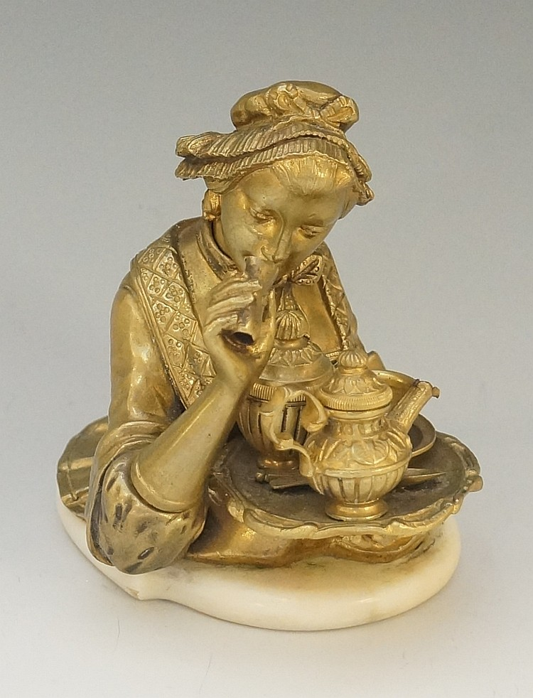 An interesting Victorian brass novelty inkwell modelled as the upper body o