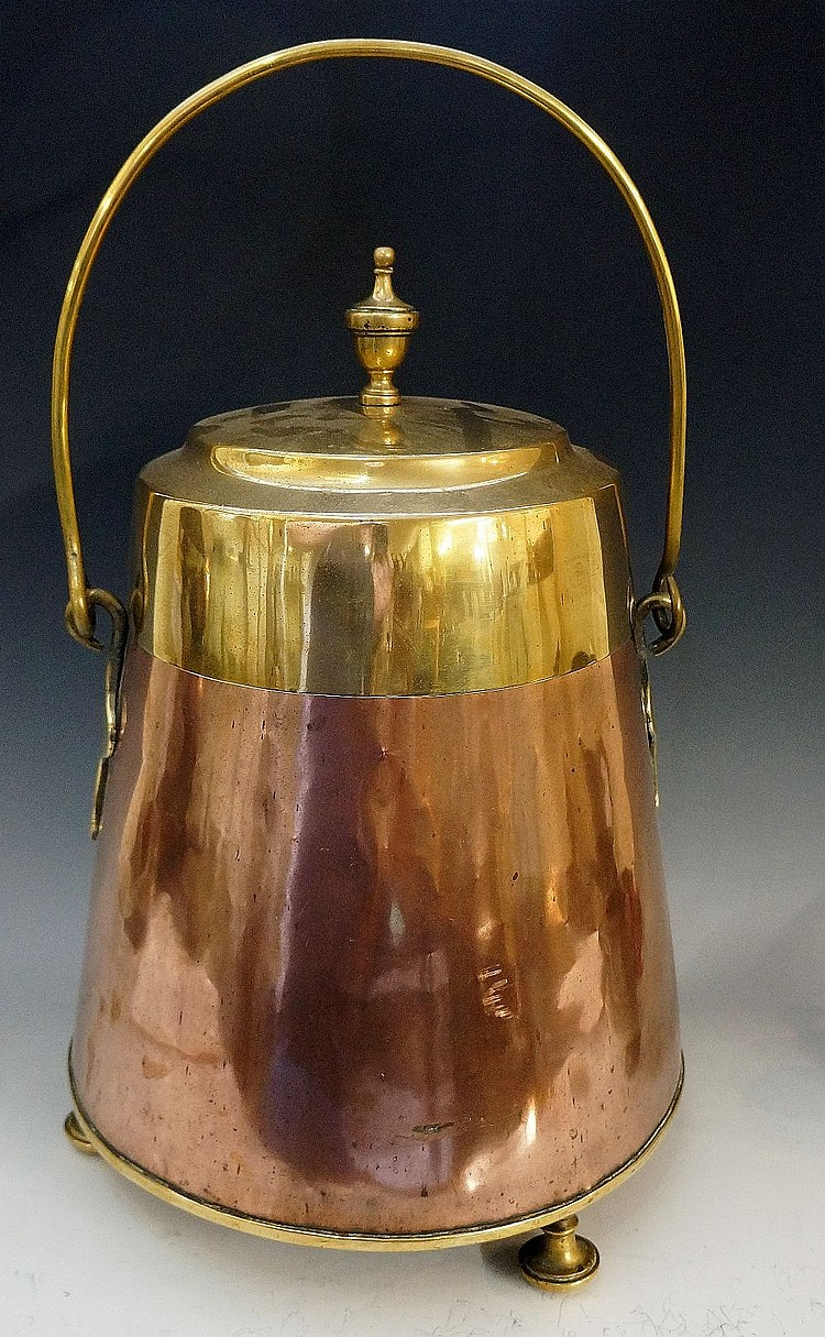 A copper and brass coal bin, the brass top with urnular final, the tapered