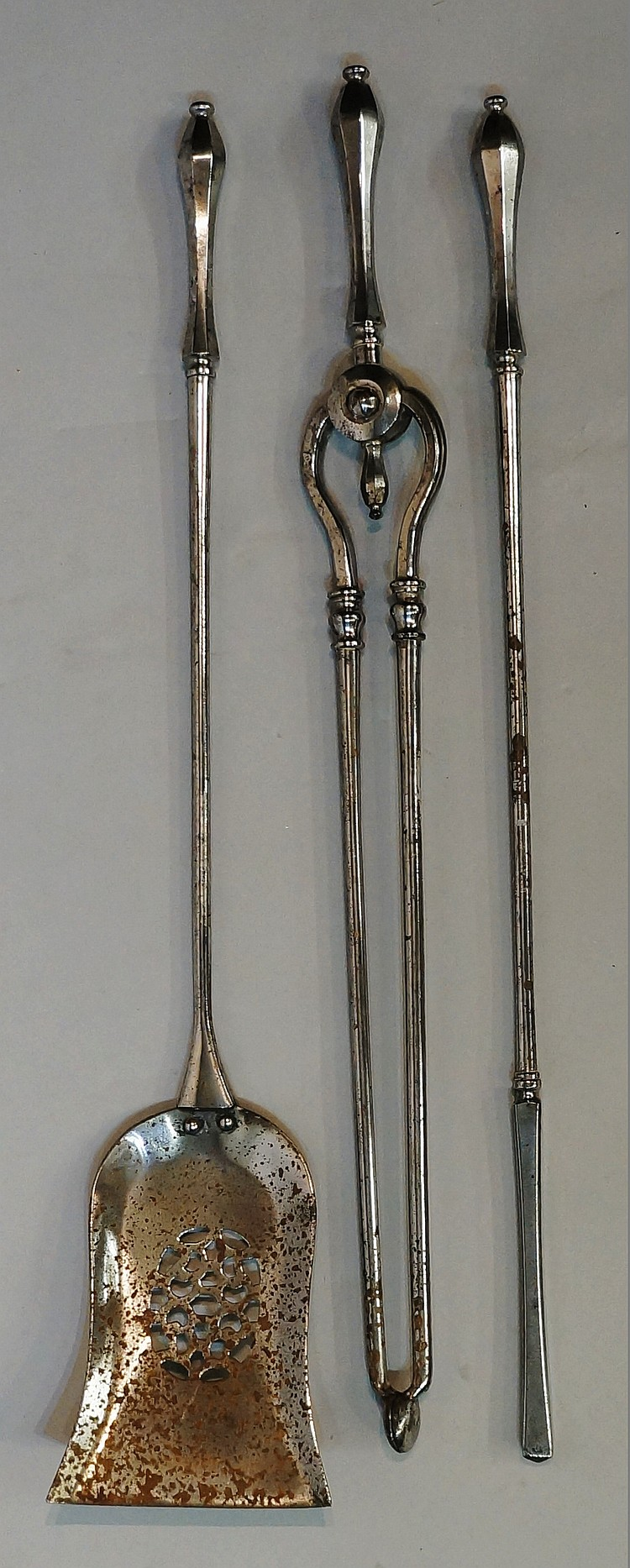 A set of three late 18th / early 19th Century polished steel fire irons com