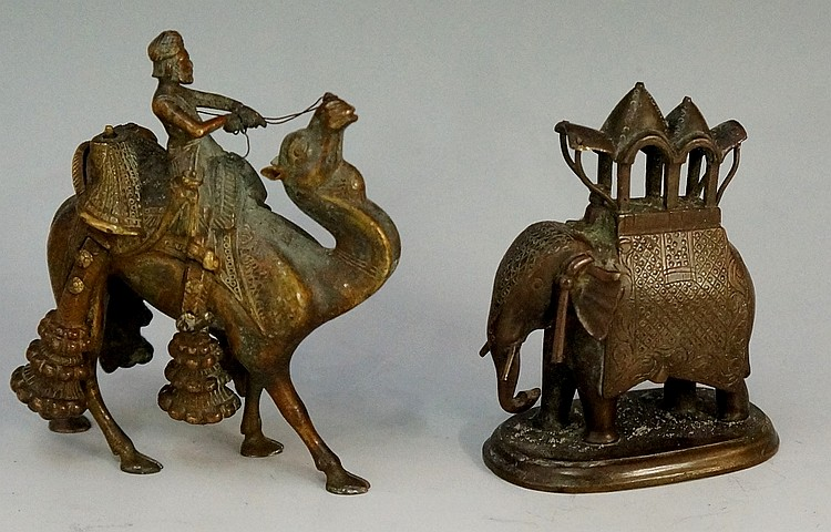 A bronze model of an Indian elephant with a howdah on its back, 7cm high; a