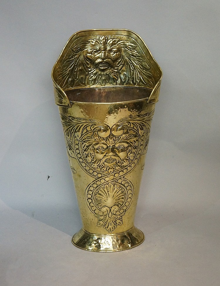 A 19th Century embossed brass grape carrier, the back with leafy mask the f