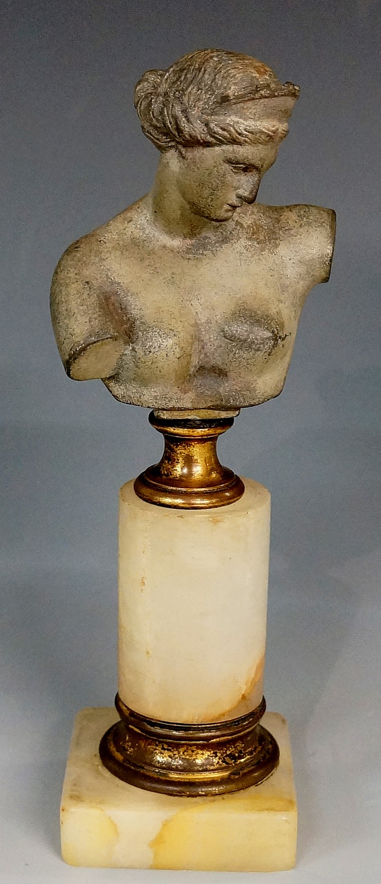 A German bronzed white metal head and shoulder bust of a classical female o